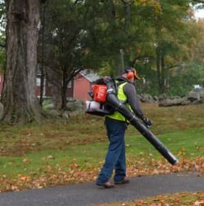 Garden worker using a gas powered leaf blower