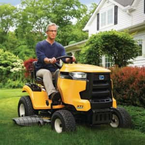 Man using a yellow riding mower