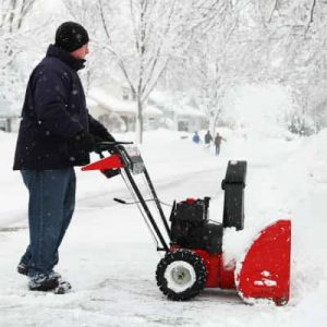 Red snowblower needing repair