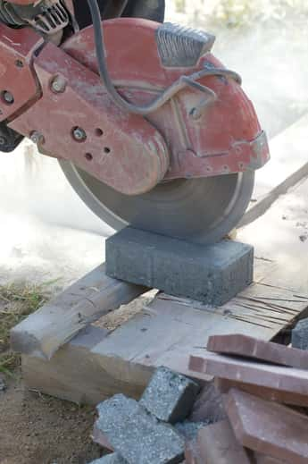 Concrete saw cutting paving slab