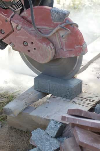 Concrete saw cutting paving slab