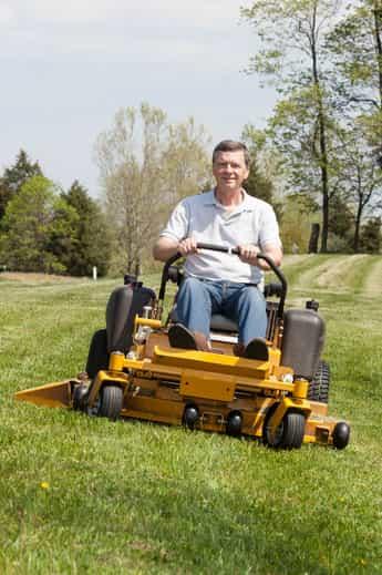 Older man riding zero-turn lawnmower