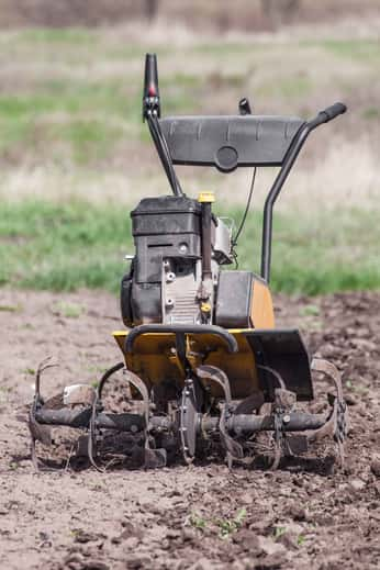 Soil cultivator sitting on a plot of land